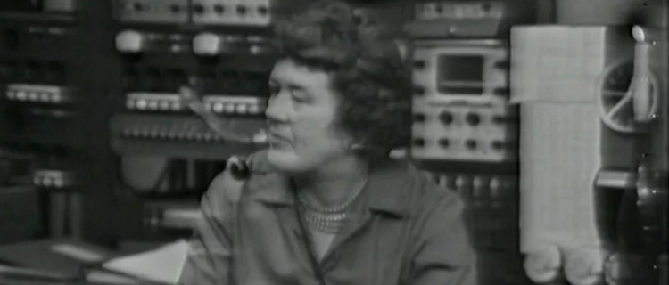 American Archive of Public Broadcasting. Julia Child wears a head microphone in this black and white image.