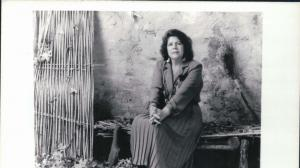 Native American woman seated on a bench. Wilma Mankiller overcame rampant sexism and personal challenges to emerge as the Cherokee Nation's first woman Principal Chief in 1985. Credit: Wilma Mankiller Foundation