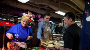 Lidia Bastianich and Bob Woodruff serve U.S Army veteran and Purple Heart recipient Marlene Rodriguez during an intimate holiday meal aboard the USS George Washington. Credit: Meredith Nierman/WGBH
