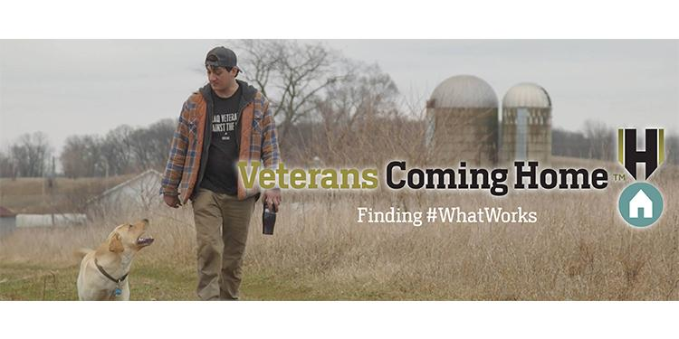Veteran walks with dog through straw field