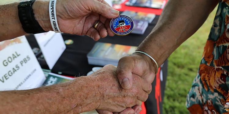 Vegas PBS volunteers present veterans with Vietnam Veteran Honor Coin. Military and Veterans Appreciation Day on Saturday, September 9, 2017 at Craig Ranch Regional Park, Las Vegas, NV. Courtesy: Vegas PBS