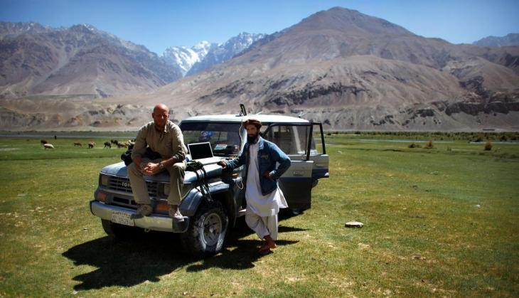 "NPR photographer David Gilkey, left, and translator Atiqullah ""Ihrar"" after covering the presidential voting day in Northern Afghanistan. Following the deaths of David Gilkey and Zabihulla Tamanna in June 2016, CPB established a memorial fund for international coverage and photojournalism in their honor. Credit: NPR"