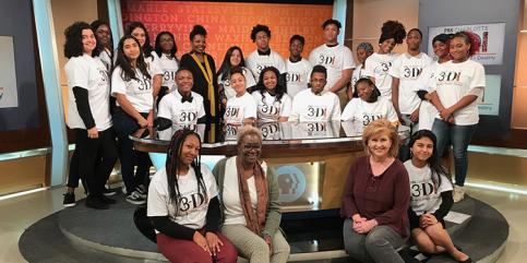 "High school students in ""Dreamers-Doers-Destiny"" program gather in PBS Charlotte studio, with General Manager Amy Burkett (right). Credit: WTVI PBS Charlotte"